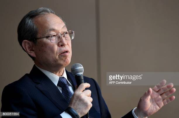 Toshiba corp president Satoshi Tsunakawa answers a question during a press conference at the company's headquarters in Tokyo on June 23 2017 Toshiba...