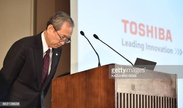 Toshiba Corp President Satoshi Tsunakawa bows at the beginning of the press conference at the company's headquarters in Tokyo on March 14 2017...