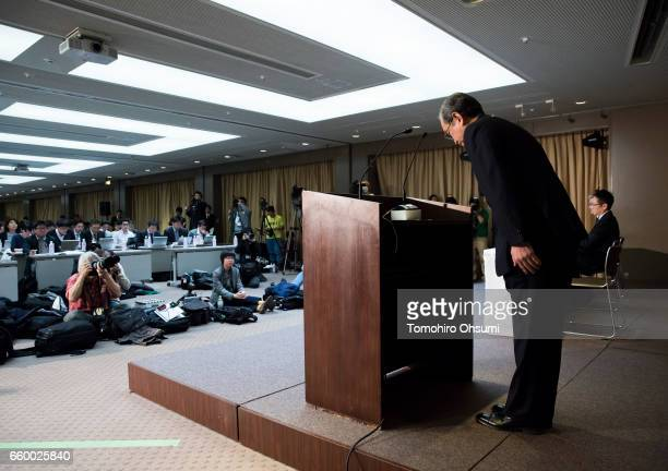 Toshiba Corp President Satoshi Tsunakawa bows to the media after speaking on the podium during a press conference on March 29 2017 in Tokyo Japan...