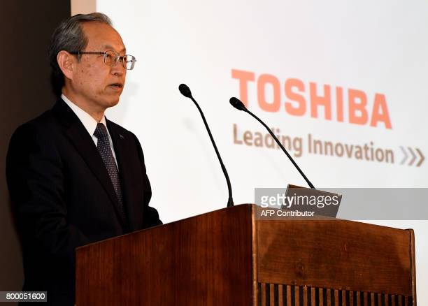 Toshiba corp president Satoshi Tsunakawa delivers his speech during a press conference at the company's headquarters in Tokyo on June 23 2017 Toshiba...
