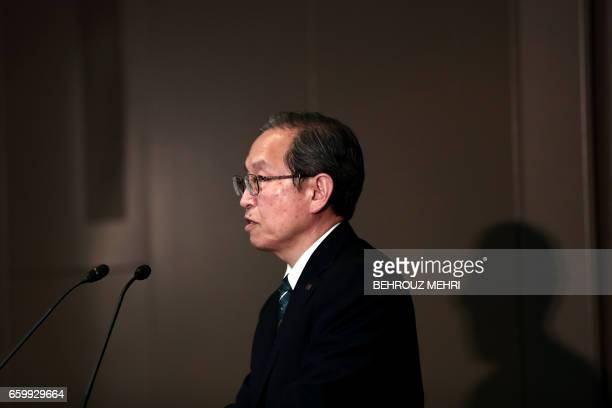 Toshiba Corp President Satoshi Tsunakawa speaks during a press conference at the company's headquarters in Tokyo on March 29 2017 Toshiba's losshit...