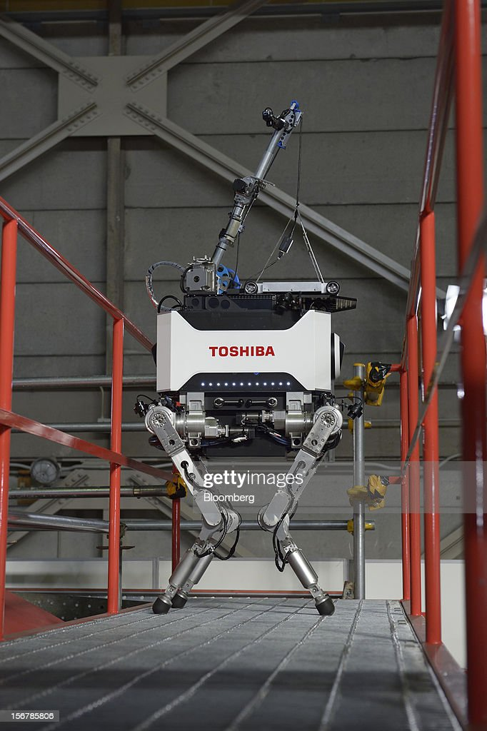 A Toshiba Corp. tetrapod robot stands on a catwalk at the company's Yokohama Complex in Yokohama City, Kanagawa Prefecture, Japan, on Wednesday, Nov. 21, 2012. Toshiba's new robot was developed to work in areas too dangerous for humans. Photographer: Akio Kon/Bloomberg via Getty Images