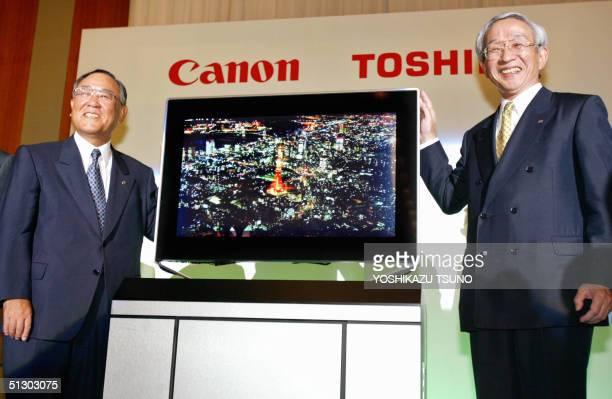 Toshiba President Tadashi Okamura and Canon President Fujio Mitarai display the prototype model of the next generation flat display panel...