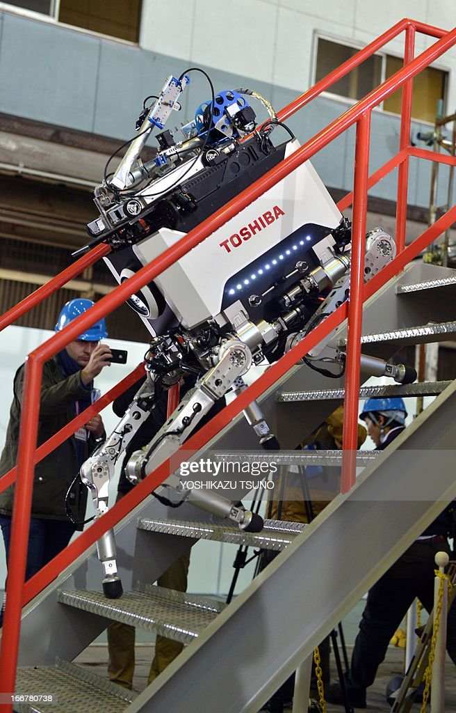 Toshiba's four-legged robot climbs steps during a demonstration at Toshiba's technical center in Yokohama, suburban Tokyo on November 21, 2012. Toshiba developed a tetrapod robot, enabling it to carry out investigative and recovery work in TEPCO's Fukushima nuclear power plant. The robot weighs 65 kilograms and can move over uneven surfaces. AFP PHOTO / Yoshikazu TSUNO