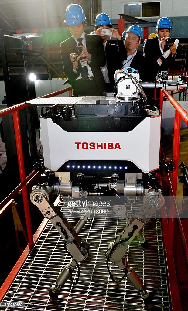 Toshiba's four-legged robot walks on a catwalk during a demonstration at Toshiba's technical center in Yokohama, suburban Tokyo on November 21, 2012. Toshiba developed a tetrapod robot, enabling it to carry out investigative and recovery work in TEPCO's Fukushima nuclear power plant. The robot weighs 65 kilograms and can move over uneven surfaces. AFP PHOTO / Yoshikazu TSUNO