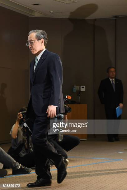 Toshiba's President Satoshi Tsunakawa arrives for a press conference at the company's headquarters in Tokyo on August 10 2017 Toshiba on August 10...