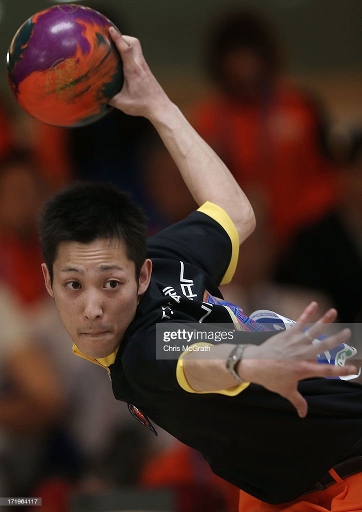 Toshihiko Takahashi of Japan bowls against Mak Cheuk Yin of Hong Kong, China during the Men's Singles Bowling semi-final at Anyang Hogye Gymnasium on day two of the 4th Asian Indoor & Martial Arts Games on June 30, 2013 in Incheon, South Korea.