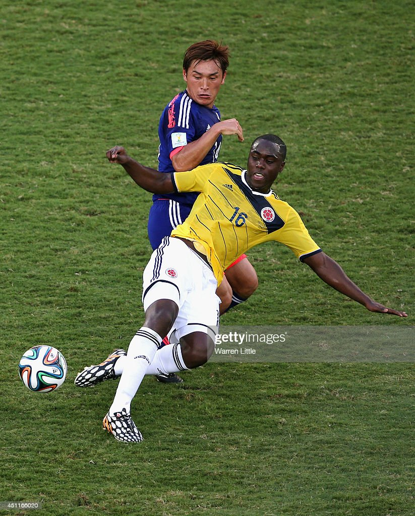 Toshihiro Aoyama of Japan challenges Eder Alvarez Balanta of Colombia during the 2014 FIFA World Cup Brazil Group C match between Japan and Colombia at Arena Pantanal on June 24, 2014 in Cuiaba, Brazil.
