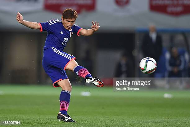 Toshihiro Aoyama of Japan strikes the ball to score Japan's first goal during the international friendly match between Japan and Uzbekistan at...