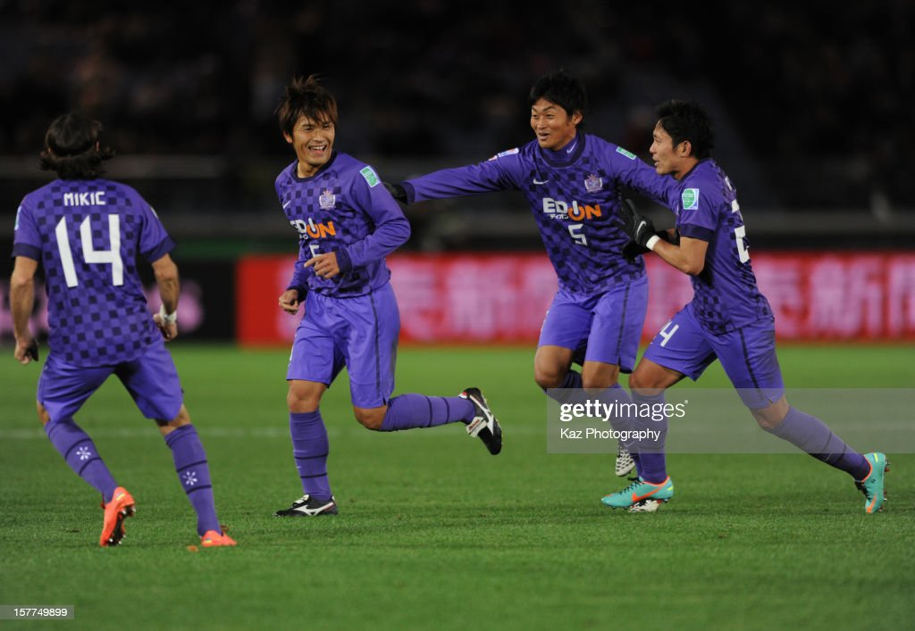 Toshihiro Aoyama of Sanfrecce Hiroshima celebrates his goal with his team mates, Kazuhiko Chiba and Ryota Moriwaki of Sanfrecce Hiroshima during the FIFA Club World Cup match between Sanfrecce Hiroshima and Auckland City at International Stadium Yokohama on December 6, 2012 in Yokohama, Japan.