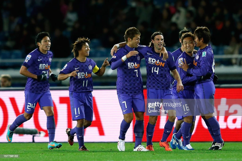 Toshihiro Aoyama (R) of Sanfrecce Hiroshima celebrates his goal with team mates during the FIFA Club World Cup match between Sanfrecce Hiroshima and Auckland City at International Stadium Yokohama on December 6, 2012 in Yokohama, Japan.
