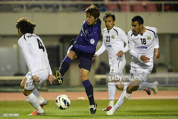 Toshihiro Aoyama of Sanfrecce Hiroshima competes for the ball during the AFC Champions League Group G match between Sanfrecce Hiroshima and Bunyodkor...