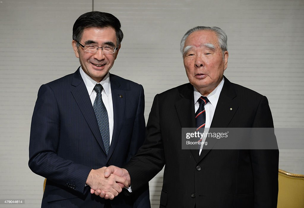 Toshihiro Suzuki, president of Suzuki Motor Corp., left, poses for a photograph with <a gi-track='captionPersonalityLinkClicked' href=/galleries/search?phrase=Osamu+Suzuki&family=editorial&specificpeople=580987 ng-click='$event.stopPropagation()'>Osamu Suzuki</a>, chief executive officer of Suzuki Motor Corp., during a news conference in Tokyo, Japan, on Tuesday, June 30, 2015. <a gi-track='captionPersonalityLinkClicked' href=/galleries/search?phrase=Osamu+Suzuki&family=editorial&specificpeople=580987 ng-click='$event.stopPropagation()'>Osamu Suzuki</a>, the longest-serving leader of any major global automaker, will cede his title as president of Suzuki to his son, Toshihiro Suzuki. Photographer: Akio Kon/Bloomberg via Getty Images