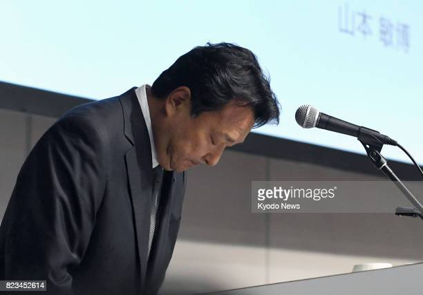 Toshihiro Yamamoto president of Japan's leading ad agency Dentsu Inc bows in apology after announcing the company's basic plan to improve working...