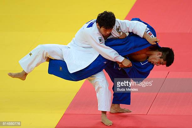 Toshimasa Ogata of Japan fights with Eduardo Yudi Santos of Brazil during the 81kg category men final at the International Judo Tournament Aquece Rio...