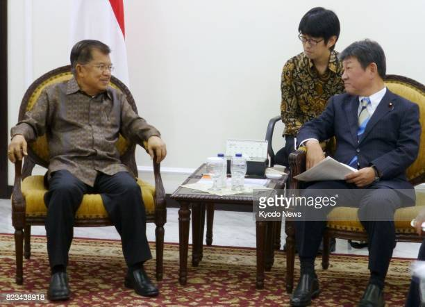Toshimitsu Motegi chairman of Japan's ruling Liberal Democratic Party's Policy Research Council and Indonesian Vice President Muhammad Jusuf Kalla...