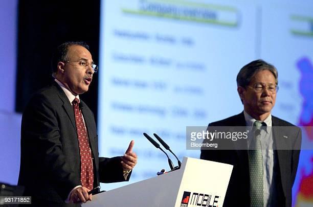Toshinari Kunieda senior vice president of NTT DoCoMo Inc right listens as Anil Kumar Sardana managing director of Tata Teleservices Ltd speaks...