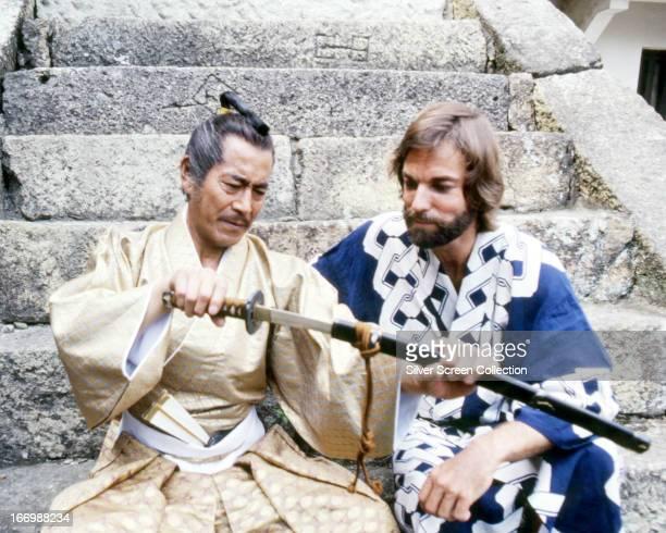 Toshiro Mifune as Yoshi Toranaga and American actor Richard Chamberlain as John Blackthorne examine a samurai sword in the TV miniseries 'Shogun' 1980