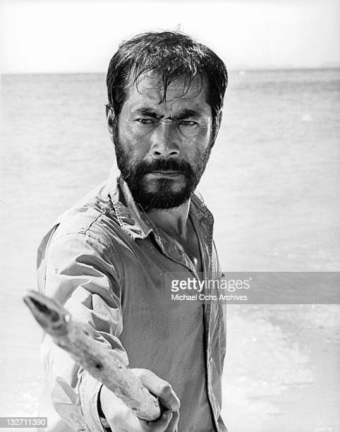 Toshiro Mifune faces the grim reality of battle with his enemy the lone American on the desolate island in a scene for the film 'Hell In The Pacific'...