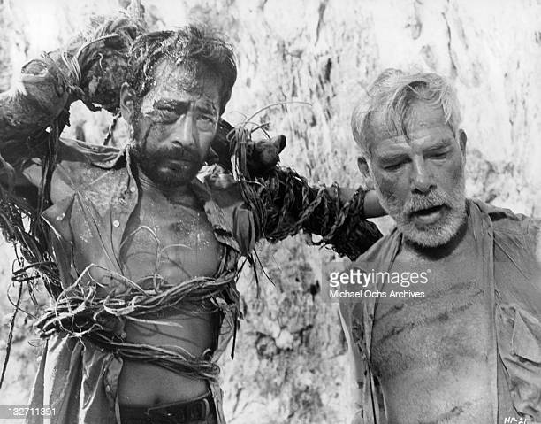 Toshiro Mifune is restrained by seaweed by Lee Marvin in a scene for the film 'Hell In The Pacific' 1968