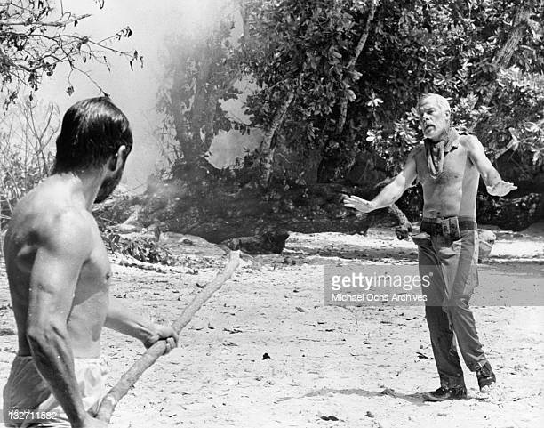 Toshiro Mifune's temper is hardly subdued by Lee Marvin's cool and casual approach in a scene for the film 'Hell In The Pacific' 1968