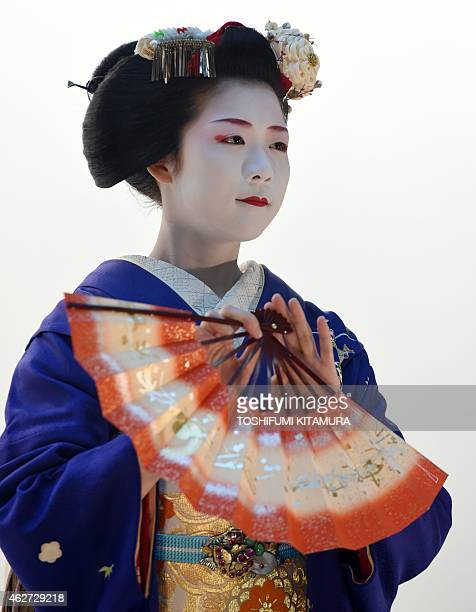 Toshisumi a 'Maiko' or apprentice geisha from Kyoto's Miyakawa cho performs a traditional dance during the opening ceremony of the 'Kyo Aruki in...