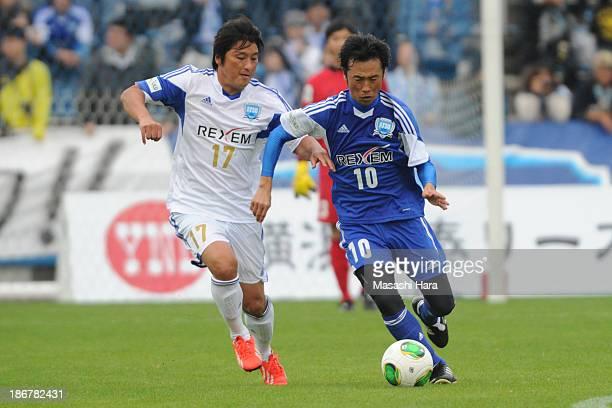 Toshiya Fujita and Atsuhiro Miura compete for the ball during the Atsuhiro Miura Retirement match at Nippatsu Mitsuzawa Stadium on November 4 2013 in...
