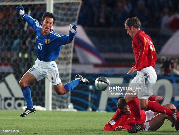 Toshiya Fujita of Japan is tackled by Christian Schulz of Germany during the international friendly match between Japan and Germany at the...