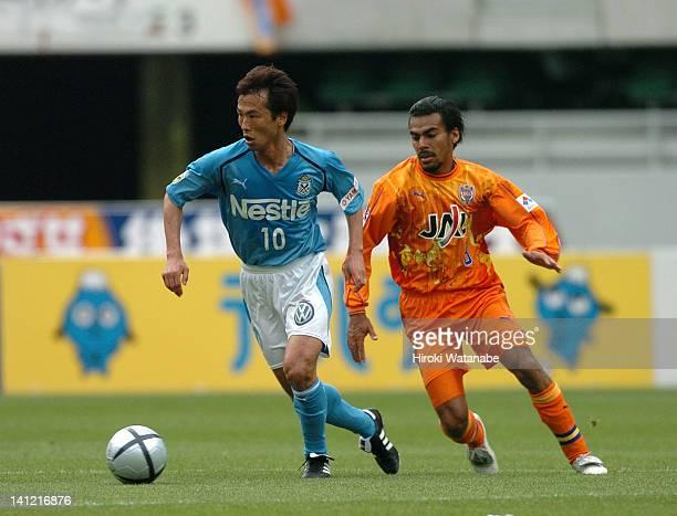 Toshiya Fujita of Jubilo Iwata and Clemerson de Araujo Soares of Shimizu SPulse compete for the ball during the JLeague match between Shimizu SPulse...