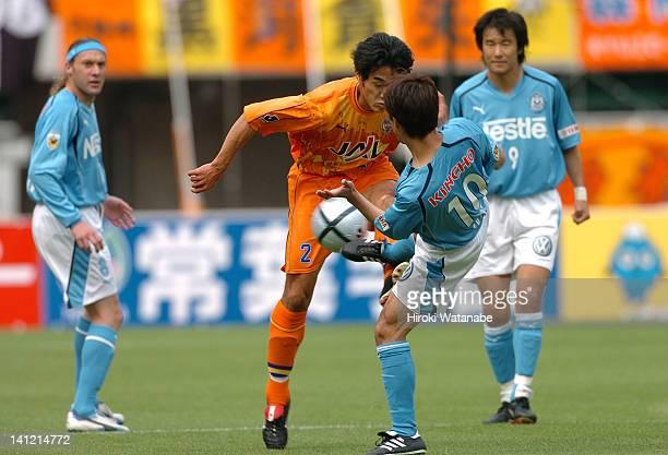 Toshiya Fujita of Jubilo Iwata and Toshihide Saito of Shimizu SPulse compete for the ball during the JLeague match between Shimizu SPulse and Jubilo...