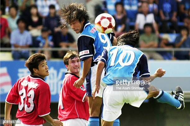 Toshiya Fujita of Jubilo Iwata heads the ball to score his team's first goal during the JLeague match between Jubilo Iwata and Urawa Red Diamonds at...