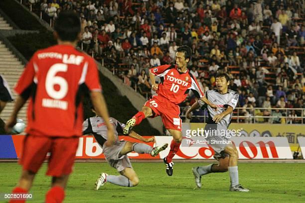 Toshiya Fujita of Nagoya Grampus Eight scores his team's first goal during the JLeague match between Nagoya Grampus Eight and Yokohama FMarinos at...