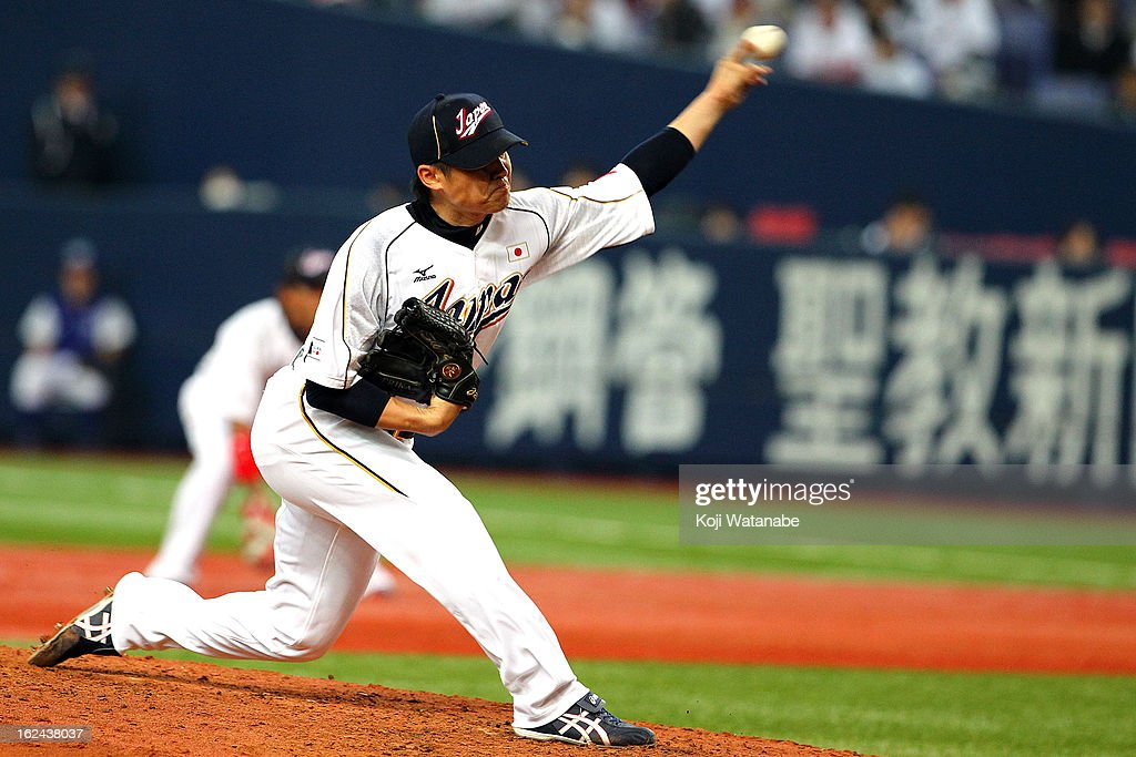 <a gi-track='captionPersonalityLinkClicked' href=/galleries/search?phrase=Toshiya+Sugiuchi&family=editorial&specificpeople=843038 ng-click='$event.stopPropagation()'>Toshiya Sugiuchi</a> #18 of Japan pitcher against Australia in the top half of the fourth inning during international friendly game between Japan and Australia at Kyocera Dome Osaka on February 23, 2013 in Osaka, Japan.