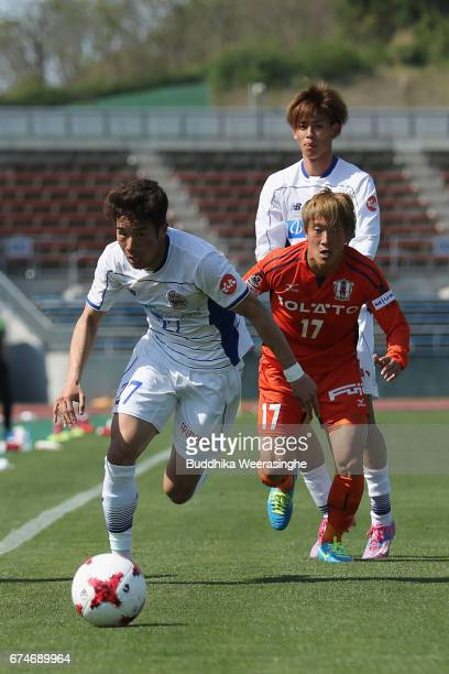 Toshiya Takagi of Montedio Yamagata and Daiki Kogure of Ehime FC compete for the ball during the JLeague J2 match between Ehime FC and Montedio...