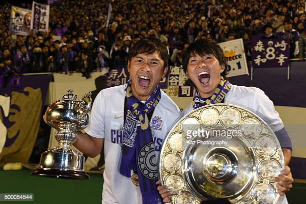 Toshiyuki Aoyama and Hisato Sato of Sanfrecce Hiroshima cele brate the title with the Schale and the Cup during the JLeague 2015 Championship final...