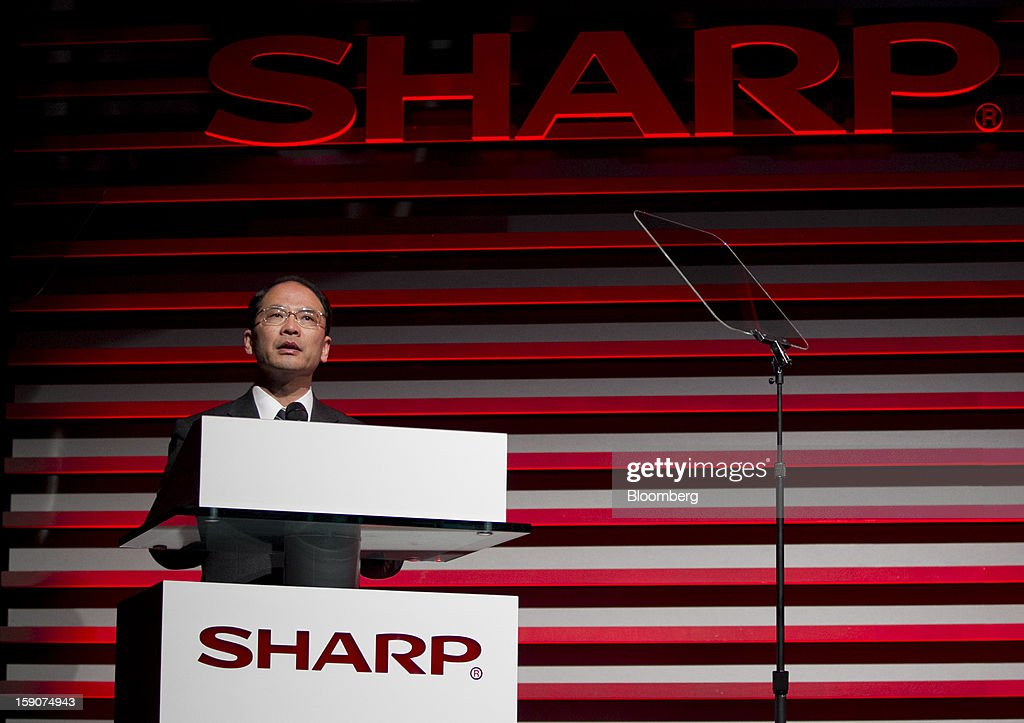 Toshiyuki Osawa, chairman and chief executive officer of Sharp Corp., speaks during a news conference prior to the 2013 Consumer Electronics Show in Las Vegas, Nevada, U.S., on Monday, Jan. 7, 2013. The 2013 CES trade show, which runs until Jan. 11, is the world's largest annual innovation event that offers an array of entrepreneur focused exhibits, events and conference sessions for technology entrepreneurs. Photographer: Andrew Harrer/Bloomberg via Getty Images