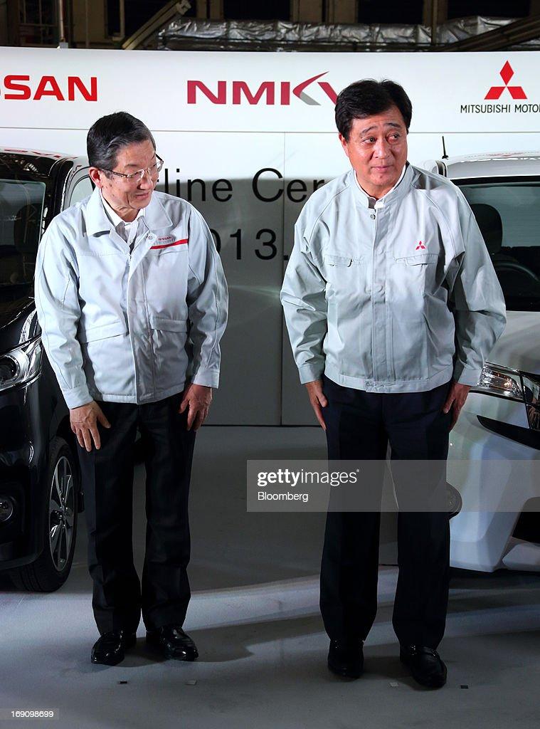 Toshiyuki Shiga chief operating officer of Nissan Motor Co left and Osamu Masuko president of Mitsubishi Motors Corp bow during their companies' line...
