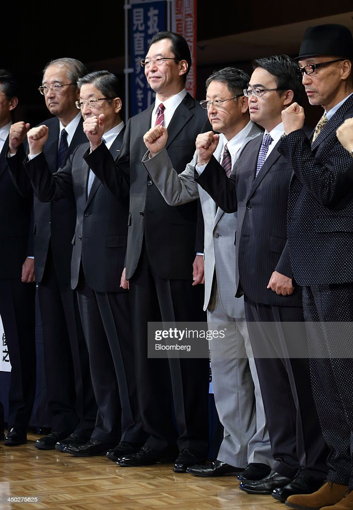 Toshiyuki Shiga vice chairman of Nissan Motor Co from second left to right Fumihiko Ike chairman of Honda Motor Co and Akio Toyoda president of...