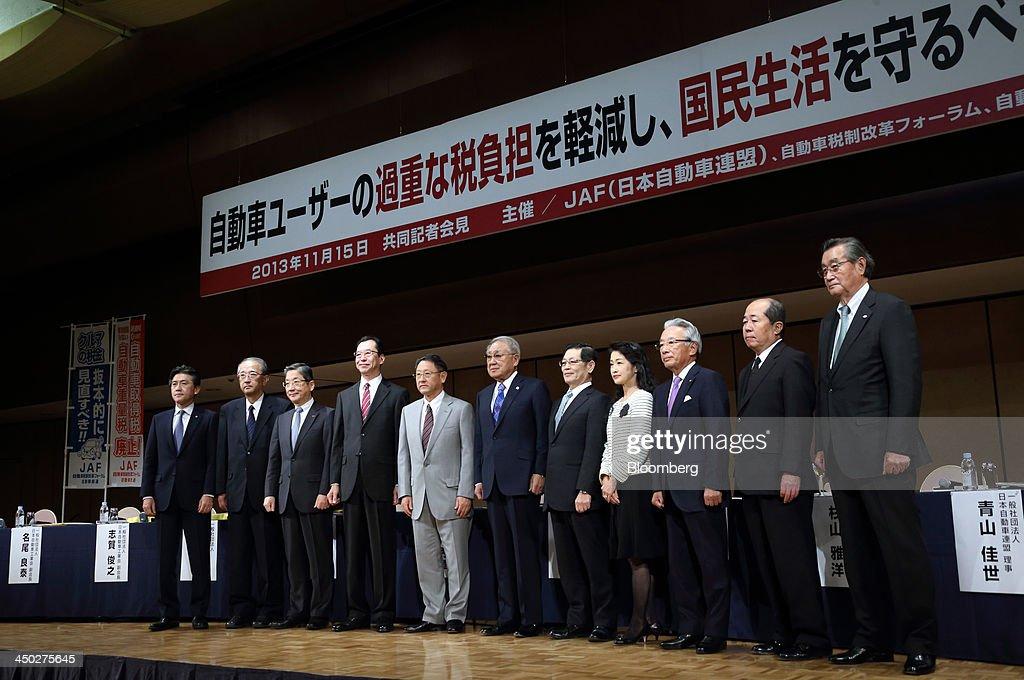 Toshiyuki Shiga vice chairman of Nissan Motor Co from third left to right Fumihiko Ike chairman of Honda Motor Co and Akio Toyoda president of Toyota...