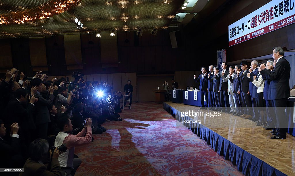 Toshiyuki Shiga vice chairman of Nissan Motor Co on stage from third left to right Fumihiko Ike chairman of Honda Motor Co and Akio Toyoda president...