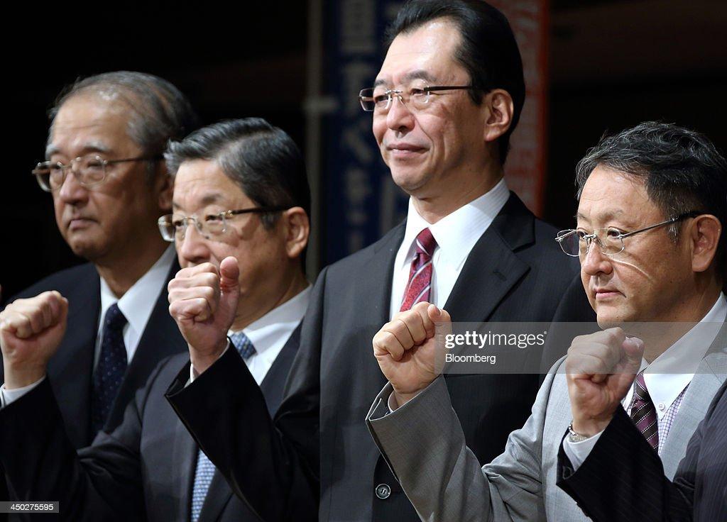 Toshiyuki Shiga vice chairman of Nissan Motor Co second left Fumihiko Ike chairman of Honda Motor Co second right and Akio Toyoda president of Toyota...