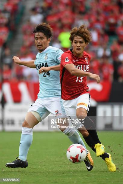 Toshiyuki Takagi of Urawa Red Diamonds and Daiki Ogawa of Jubilo Iwata compete for the ball during the JLeague J1 match between Jubilo Iwata and...