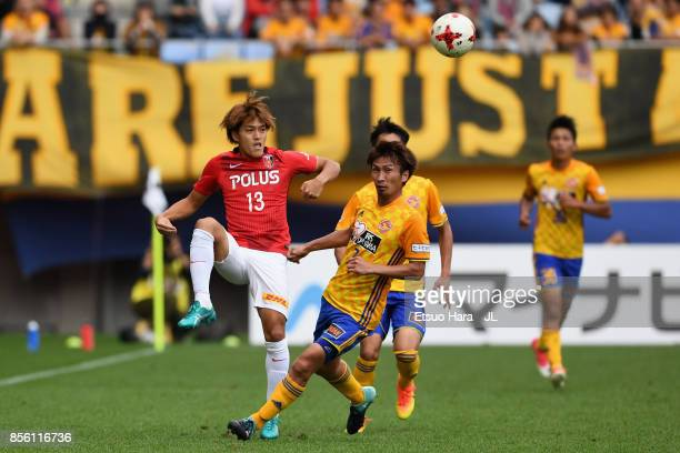 Toshiyuki Takagi of Urawa Red Diamonds and Hiroaki Okuno of Vegalta Sendai compete for the ball during the JLeague J1 match between Vegalta Sendai...
