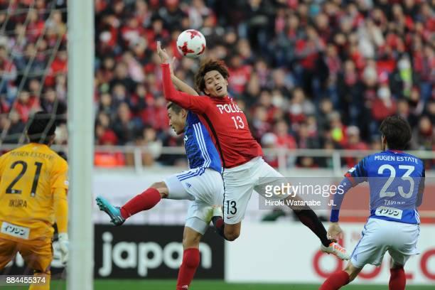 Toshiyuki Takagi of Urawa Red Diamonds and Ryosuke Yamanaka of Yokohama FMarinos compete for the ball during the JLeague J1 match between Urawa Red...