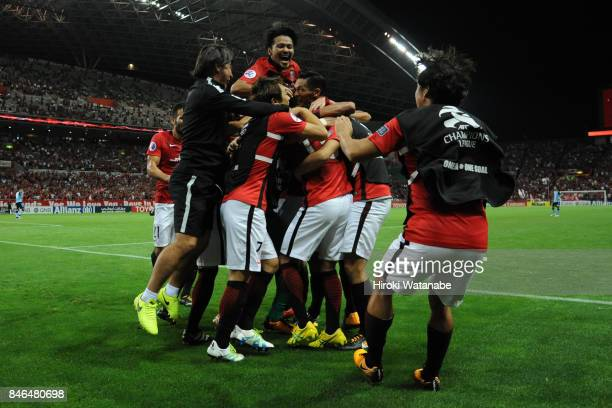 Toshiyuki Takagi of Urawa Red Diamonds celebrates scoring his team's fourth goal during the AFC Champions League quarter final second leg match...