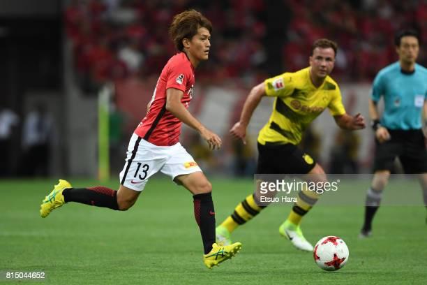 Toshiyuki Takagi of Urawa Red Diamonds in action during the preseason friendly match between Urawa Red Diamonds and Borussia Dortmund at Saitama...