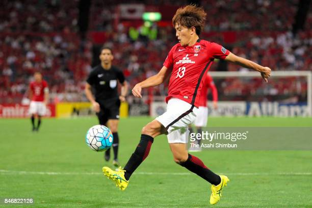 Toshiyuki Takagi of Urawa Red Diamonds scores his side's fourth goal during the AFC Champions League quarter final second leg match between Urawa Red...