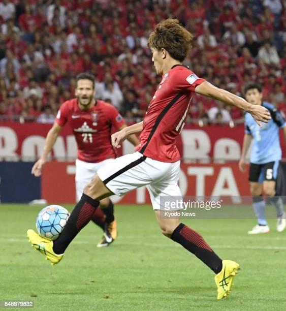 Toshiyuki Takagi scores Urawa Reds' fourth goal in the second leg of their Asian Champions League quarterfinal tie against Kawasaki Frontale at...