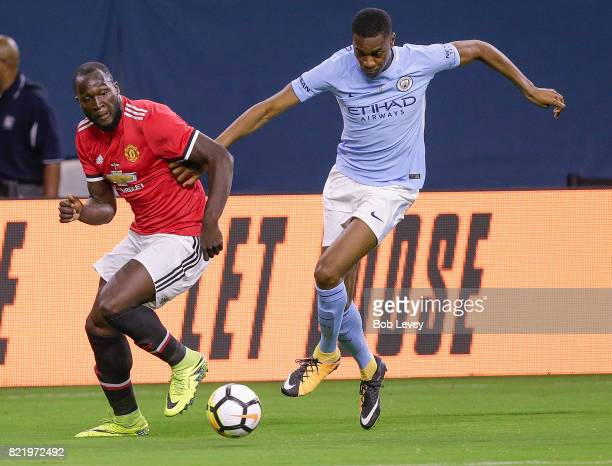 Tosin Adarabioyo of Manchester City breaks away from Marcus Rashford of Manchester United at NRG Stadium on July 20 2017 in Houston Texas