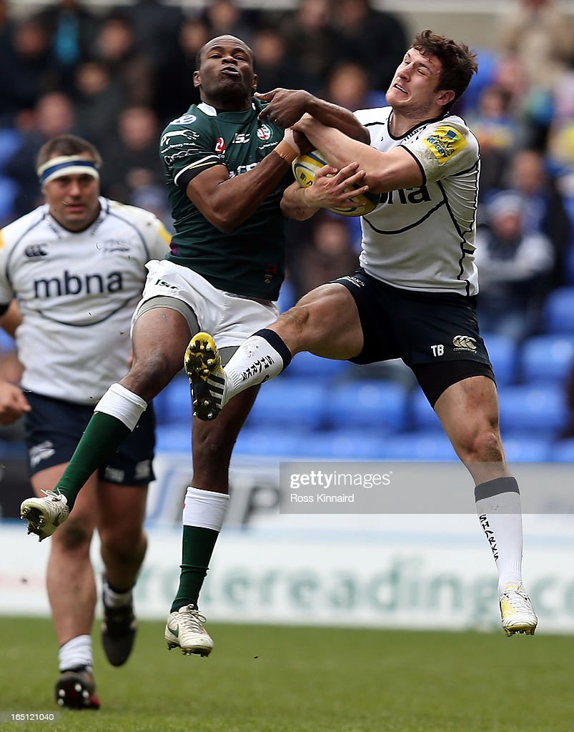Tospy Ojo of London Irish is tackled by <a gi-track='captionPersonalityLinkClicked' href=/galleries/search?phrase=Tom+Brady+-+Rugby+Union+Player&family=editorial&specificpeople=13635212 ng-click='$event.stopPropagation()'>Tom Brady</a> of Sale during the Aviva Premiership match between London Irish and Sales Sharks at the Madejski Stadium on March 31, 2013 in Reading, England.